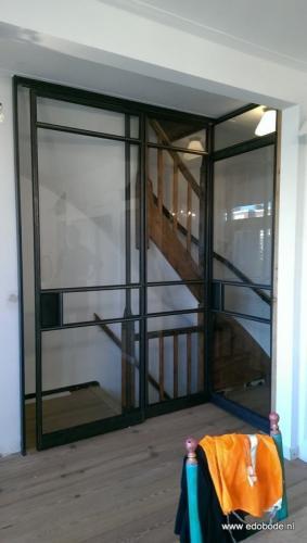 schuifdeur gecombineerd met taatsdeur bovenaan trap